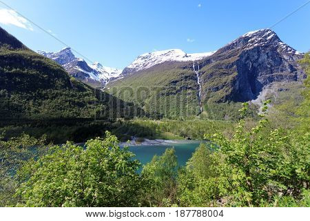 The Ice-cold Water From The Glacier In Loen Makes The Water Green.