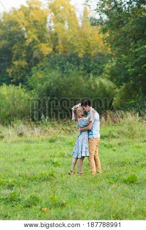 beautiful young couple hugging in the park.