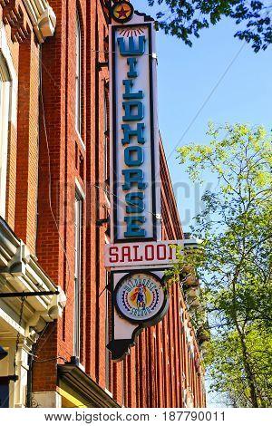 Nashville, TN, USA - 04/05/2015: Wildhorses Saloon neon sign on 3rd Ave N in downtown Nashville TN