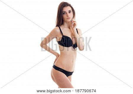 young sexy wonderful beautiful girl in black lingerie posing on camera isolated on white background