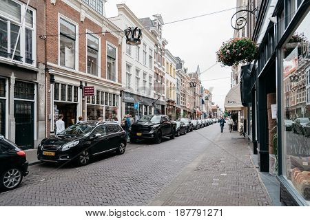 The Hague The Netherlands - August 7 2016: View of typical commercial street in the Hague a cloudy day of summer.