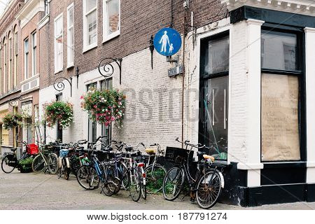 The Hague The Netherlands - August 7 2016: View of typical street in the Hague with bicycles parked