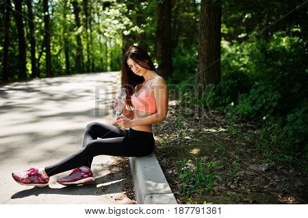 Fitness Sport Girl In Sportswear Sitting At Road In Park With Water At Bottle, Outdoor Sports, Urban