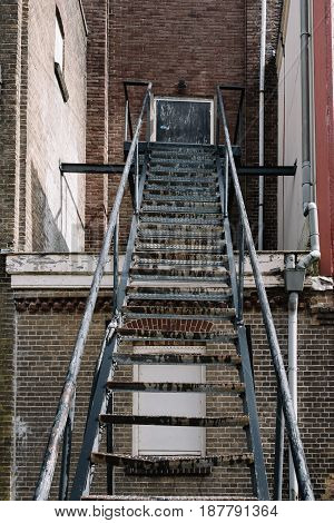 Fire escape staircase on an old brick building. Low angle view