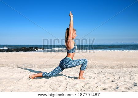 Yoga Outdoors - Woman Practicing Yoga At Beach