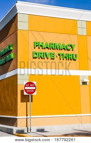Port Charlotte, FL, USA - 04/15/2016: Bright green Pharmacy Drive Thru wall sign in a Port Charlotte FL shopping mall