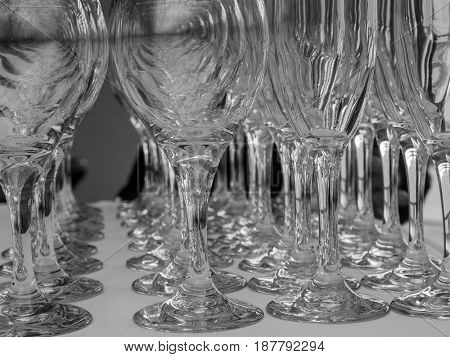 empty glasses on a table ready for dinner service