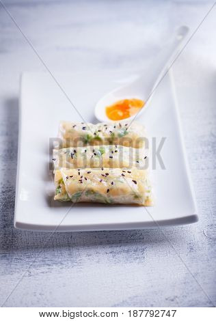 Spring Rolls with Sauce on a plate. Asian food