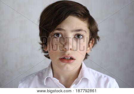 preteen boy with fear afraid expression close up portrait
