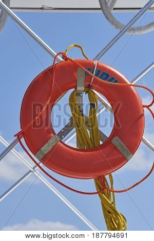 life ring and rope hanging on pleasure boat