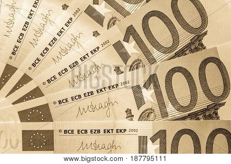 abstract banknote fragment hundred euros for financial background or for wallpaper of sepia color