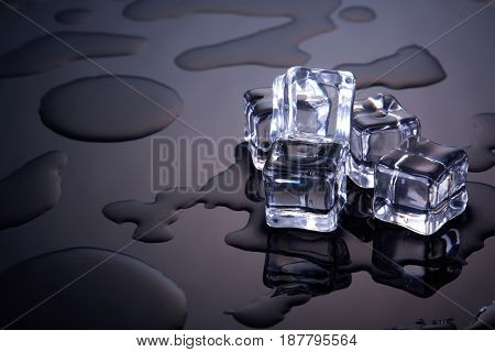 Ice cubes on a dark background with water drops. Melting ice.