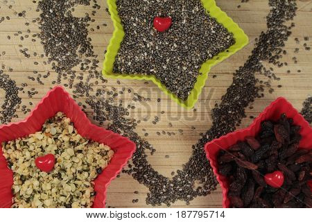 Chia seeds,hemp seeds and goji berries/ These are chia and hemp seeds and goji berries in  star bowls.