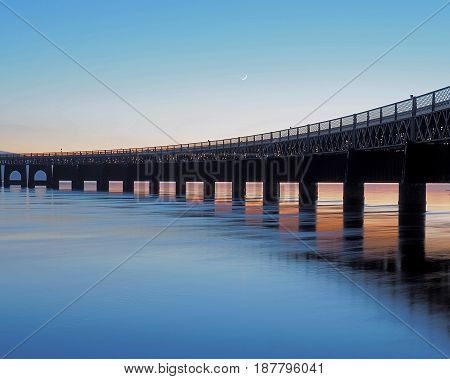Bridge on the Tay River. Dundee, Scotland - January 29, 2017 The frozen river Tay and the road bridge in the Scottish city of Dundee.