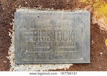 CAMDEBOO NATIONAL PARK SOUTH AFRICA - MARCH 22 2017: A plaque next to the road the Valley of Desolation viewpoint near Graaff Reinet in the Eastern Cape Province