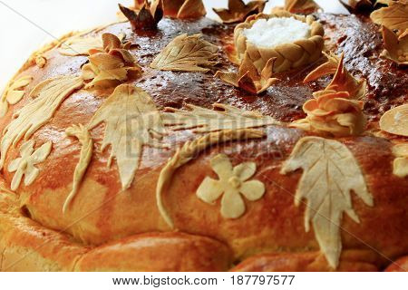 beautiful round loaf with floral pattern of flowers and leaves with salt