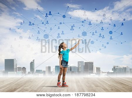 Cute kid girl standing on wooden floor and play with plane