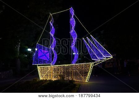 A glowing ship with a night in the Park on dark background