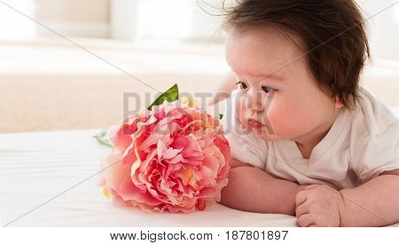 Happy Baby Boy With Pink Flower