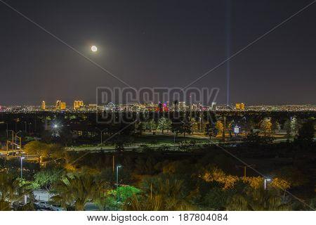 Las Vegas, Nevada, USA - May 13, 2017:  Night view of Las Vegas Strip casino resorts with moon in Southern Nevada.