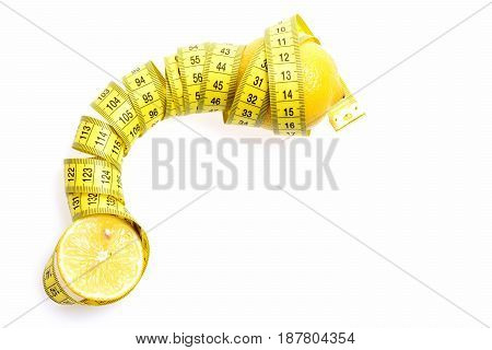 Health And Diet Concept. Tape-measure Twined Around Lemon Isolated White