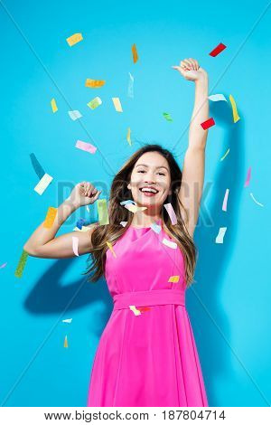 Happy Woman Celebrating With Confetti