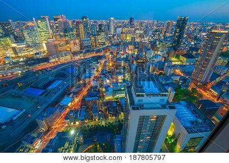 Aerial view of Osaka City Central Business downtown at twilight. Osaka Skyline from Floating Garden Observatory Umeda Sky Building in Kita Ward, Japan.
