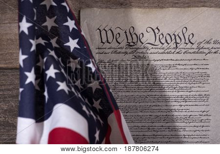 United States constitution with american flag in foreground
