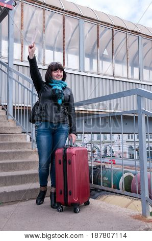 Woman Is Standing On A Platform And Waving Her Hand