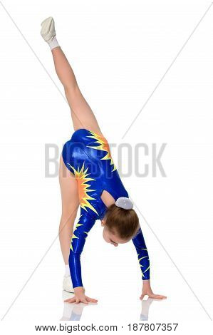Beautiful Russian girl gymnast younger school age, in blue in a sports swimsuit.A girl is performing a handstand.Isolated on white background.