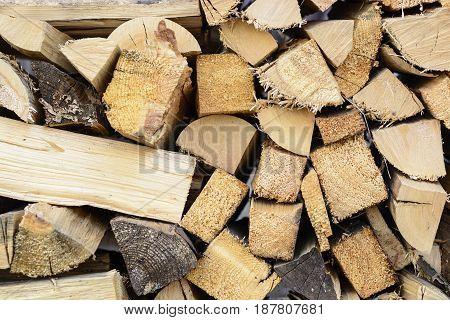 firewood background - split hardwood kiln-dried. split firewood in the stack