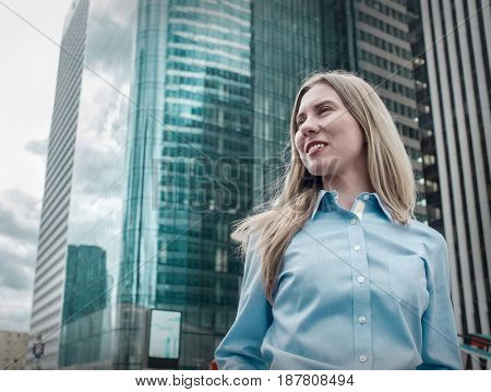Businesswoman. Happiness businessman stay around skyscrapers in La Defence district in Paris City with sky background.