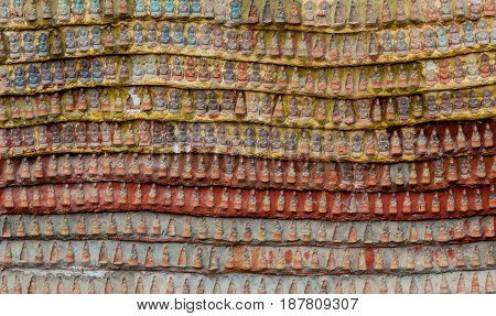 Carvings Withs Sitting Buddhas In Kaw Goon Cave In Myanmar.