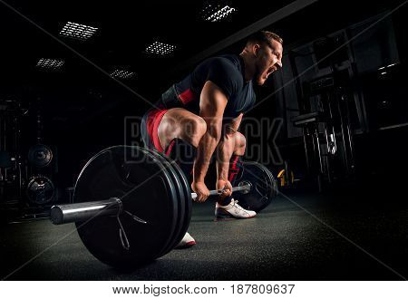 Athlete Screams To Motivate Himself To Perform An Exercise Called Deadlift