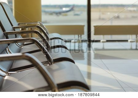 Empty chairs in the departure hall at international airport
