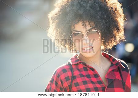 Fashionable Young African American Woman Wearing Sunglasses, Urban Scene.