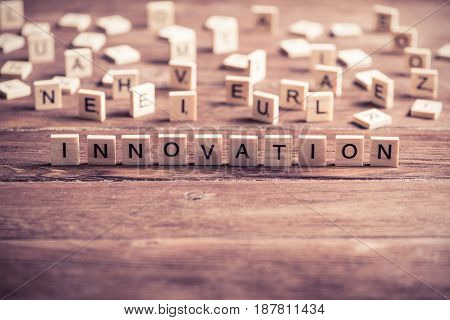 Concept of innovation made of wooden elements with the letters