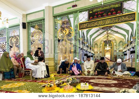 Photo of Masjid Sultan at Muscat Street in Kampong Glam district of Rochor Planning Area in Singapore. Muslim prayers inside the mosque. MARCH 2017