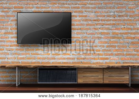 Tv on red brick wall with empty wooden table media furniture in living room interior