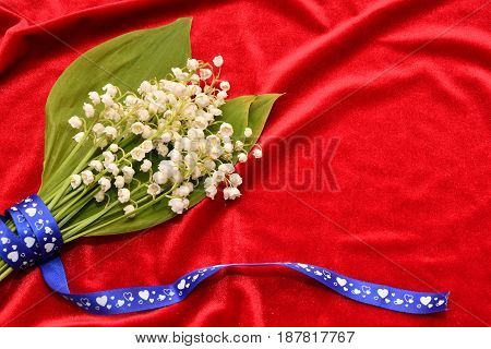Flower Of The Valley On A Red Background