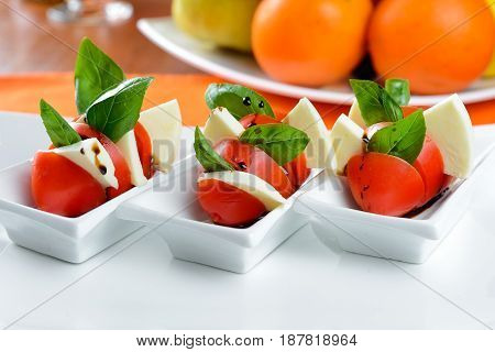 Small diet snack with cheese and tomatoes