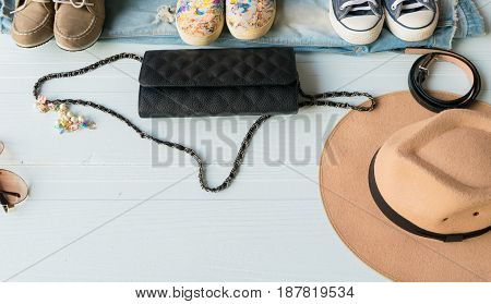 Accessories costume clothes Jeans and hats sunglasses shoes on a white background.