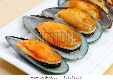 Fresh Oyster with sauce arranged in line on dish