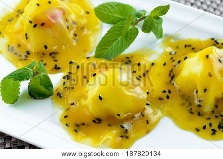 Sweet ravioli with strawberry and sweet sauce