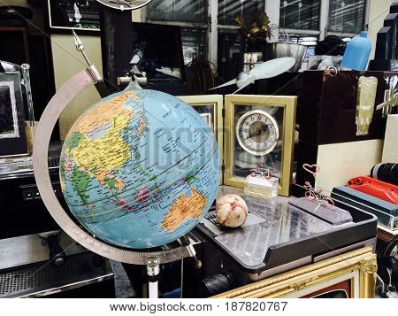 Old Geography Globe or Planet Sphere Model on Metal Stand in The Vintage and Antique Shop.