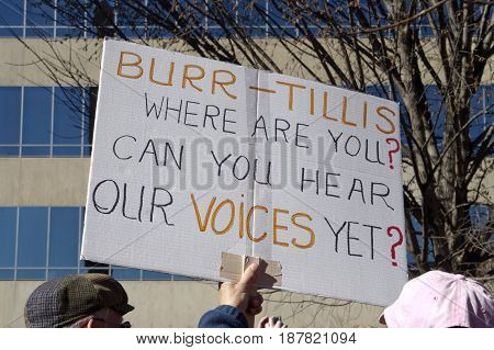 Asheville North Carolina USA - February 25 2017: North Carolina voters hold a sign at an Affordable Care Act rally directing its message to NC Republican Senators Richard Burr and Thom Tillis saying