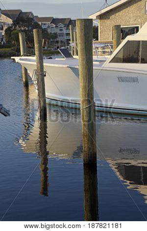 Carolina Beach, North Carolina, USA - October 27, 2016: A peaceful harbor with a docked boat on late autumn afternoon in Carolina Beach, NC