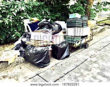 Save The Earth Concept Pile of Used Papers Cardboard Boxes and Basket Plastics Garbage Preparing for Recycling.