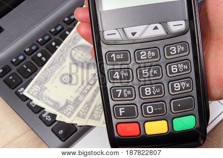 Using Payment Terminal, Currencies Dollar On Laptop In Background