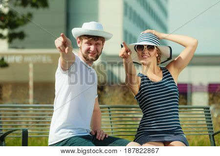 Romantic Tourists Couple Sitting On Bench